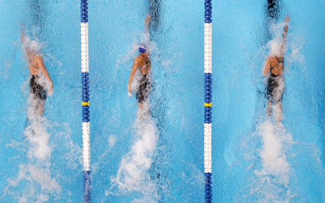 Kara Lynn Joyce, from left, Dara Torres and Jessica Hardy compete in the women's 50-meter freestyle final at the U.S. Olympic swimming trials, Monday, July 2, 2012, in Omaha, Neb. Hardy won the final. (AP Photo/Mark Humphrey)