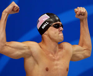 U.S. swimmer Gary Hall Jr. flexes for the crowd prior to competing in the men's 50m freestyle Friday, Sept. 22, 2000 at the Sydney International Aquatic Center during the Summer Olympics in Sydney. Hall Jr. tied with his teammate Anthony Ervin for the gold medal. (AP Photo/David Longstreath)