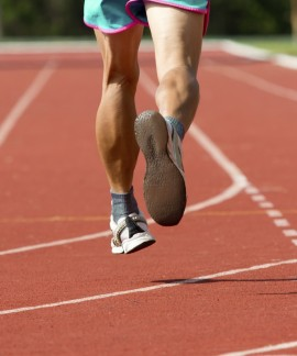 athlete running in track